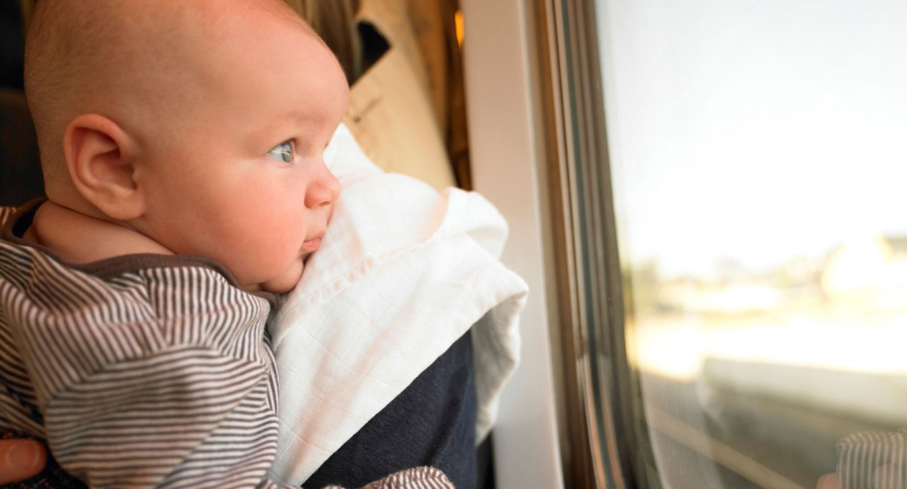 a baby look at the window
